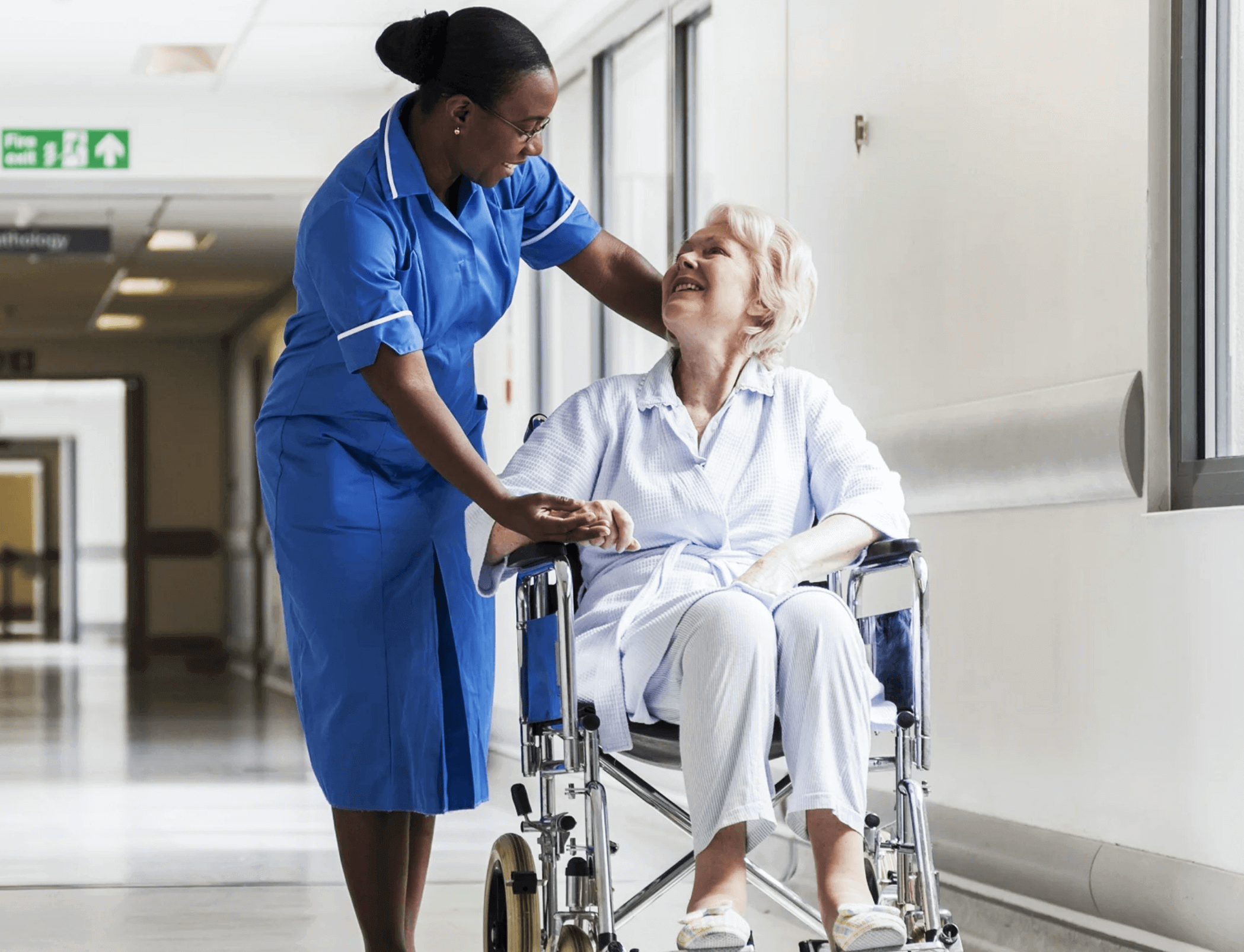 nurse with woman in wheelchair - acute care courses